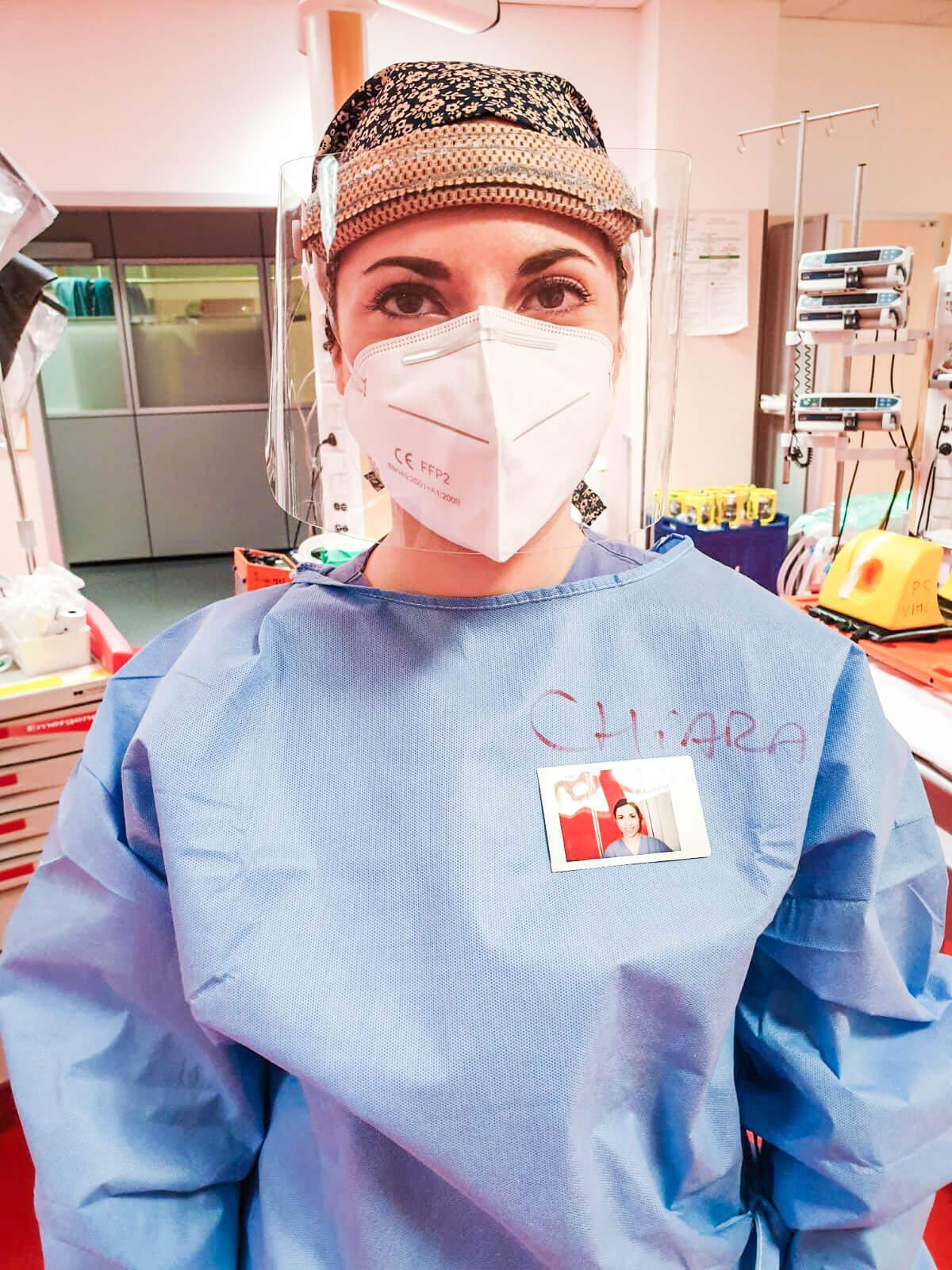 A medical worker wears an Instax portrait