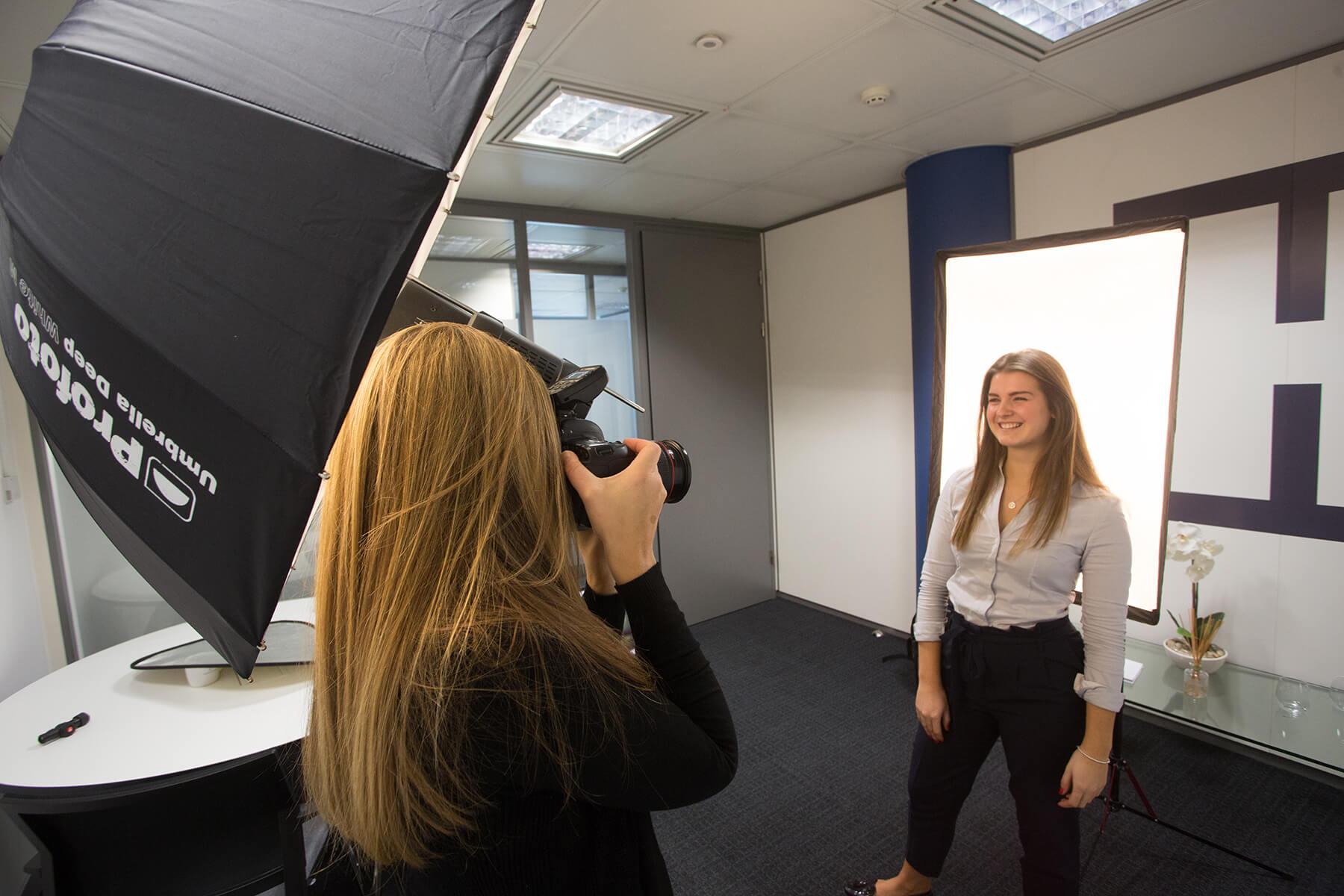 Hannah Couzens photographs a subject for Profoto Academy