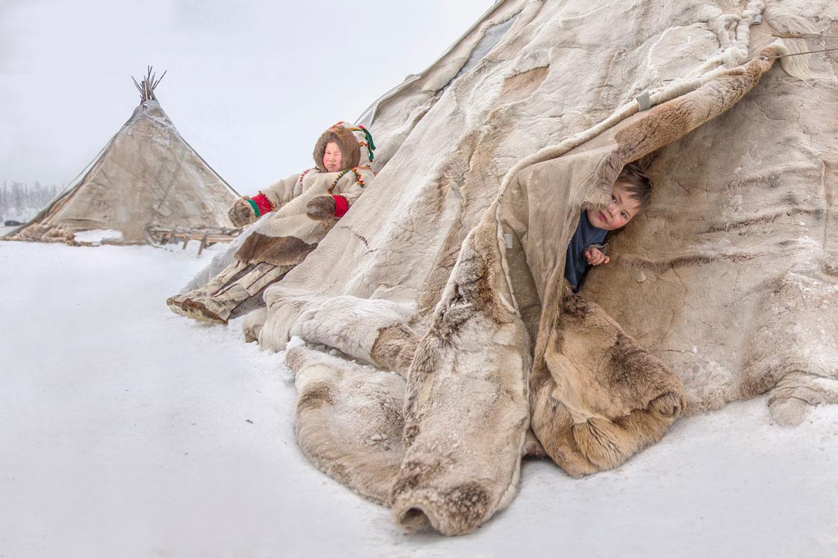 Children in a Nenets dwelling in Russia
